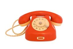 Red telephone. Red vintage telephone with disc dial isolated Stock Photo