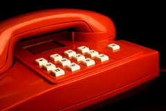 Red telephone. Isolated on black royalty free stock images