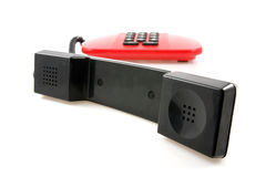 Red telephone with black receiver Stock Photography