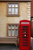 Red telephone booth. Architectural details with red telephone booth stock image