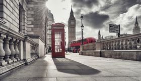 Red telephone booth and Big Ben in London, England, the UK. The Royalty Free Stock Images