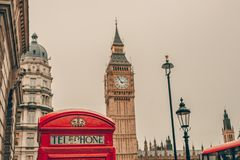 Red telephone booth and Big Ben in London Stock Photo