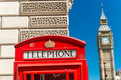 Red Telephone Booth and Big Ben in London street Stock Image