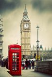 Red telephone booth and Big Ben in London, UK. royalty free stock image