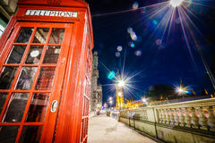 Red Telephone Booth and Big Ben at night Royalty Free Stock Images