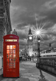Red telephone booth in front of the Big Ben. In London, United Kingdom, by night Royalty Free Stock Images