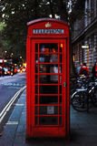 Red Telephone Booth on Gray Brick Road during Daytime Royalty Free Stock Photo