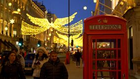 Red telephone Booth in London at Christmas time - LONDON, ENGLAND - DECEMBER 10, 2019
