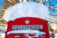 Red telephone booth in London. Famous red telephone booth in London, UK covered by snow Royalty Free Stock Image