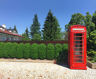 Red telephone booth in a small village Stock Photos