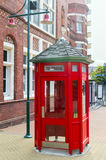 Red telephone booth at the street Stock Photography