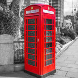 Red telephone booth on the street of London Royalty Free Stock Images
