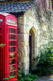 Red telephone booth, symbolic english red booth, england icon, c Stock Photos