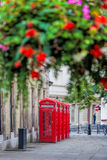 Red telephone booths in Covent Garden street, London, England Royalty Free Stock Photo