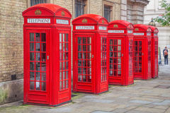 Red telephone booths in Covent Garden street, London, England Stock Photo