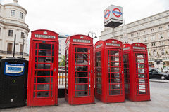 Red Telephone Booths in London England. Four red telephone booths next to Charing Cross underground station, London, England Stock Images