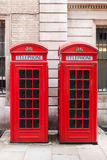 Red telephone booths. Traditional red telephone booths in London Stock Images