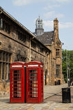 Red telephone booths in University of Glasgow stock image