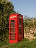 Red Telephone Box. In country vertical format royalty free stock photo