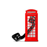 Red telephone box. With the handset on a white background Stock Photos