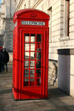 Red telephone box. London traditional red phone kiosk Stock Image