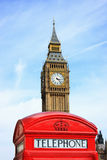 Red Telephone Box with Big Ben in background. London red phone box with Big Ben in background. Focus on phone box Stock Photo
