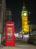 Red telephone box and Big Ben at night Royalty Free Stock Image