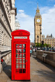 Red Telephone Box and Big Ben. Traditional Red Telephone Box and Big Ben in London, UK Stock Photo