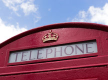 Red Telephone Box with Blue Sky Royalty Free Stock Photo