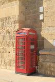 Red telephone box. A classic birtish telephone box in Valetta - Malta Royalty Free Stock Images