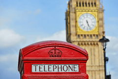 Red Telephone Box with the Clock Tower of Big Ben in London Royalty Free Stock Photography