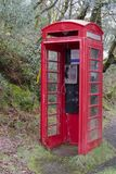 Red telephone box deserted in wilderness countryside rural area royalty free stock images
