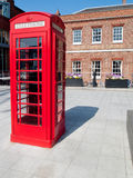 Red telephone box in front of a pub Stock Photo