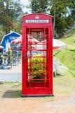 Red telephone box in garden of 7 heaven krabi thailand Stock Photography