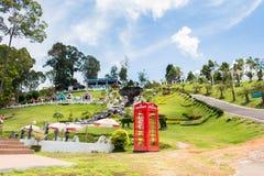 Red telephone box in garden of 7 heaven krabi thailand Royalty Free Stock Photos