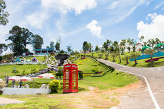 Red telephone box in garden of 7 heaven krabi thailand Royalty Free Stock Images