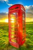 Red telephone box. In a green countryside in a Scottish suburban land, United Kingdom Stock Photography