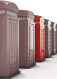 The red telephone box is highlighted, among many other Royalty Free Stock Photos