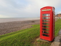Red telephone box on the Jurassic coastline Stock Image