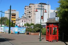 Red telephone box by lamp post, Christchurch, N Z. View into Worcester Boulevard, Christchurch, South Island, New Zealand showing various buildings, some still Royalty Free Stock Photos