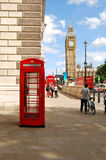 Red telephone box in London next to Big Ben in hot summer Royalty Free Stock Photo
