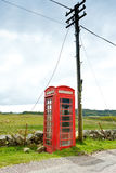 Red telephone box pole Scotland Royalty Free Stock Images