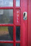 Red telephone box. Pull handle Stock Images