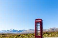 Red telephone box at a remote location Stock Images