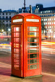 Red telephone box in street with historical architecture in Lond Royalty Free Stock Photography