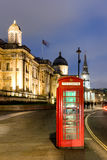 Red telephone box in street with historical architecture in Lond Stock Photo