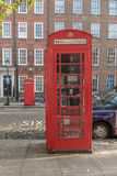 Iconic British Red Telephone Box and taxi, London. The red telephone box, a telephone kiosk for a public telephone designed by Sir Giles Gilbert Scott, was a Royalty Free Stock Photos
