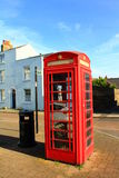 Red telephone box. Typical red telephone box and trash bin on a street in Deal,Kent United Kingdom Royalty Free Stock Image