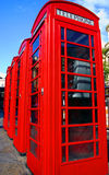 Red telephone boxes. Traditional red London telehone booths Stock Photos