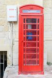 Red telephone cabin at Victoria in Gozo island, Malta. Red telephone cabin in the medieval old town of Victoria in Gozo island, Malta Royalty Free Stock Photos